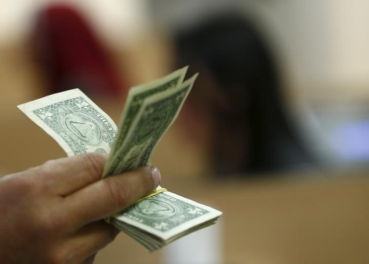 Đồng Đô la tăng nhẹ khi thị trường chờ đợi kế hoạch thắt chặt của Fed